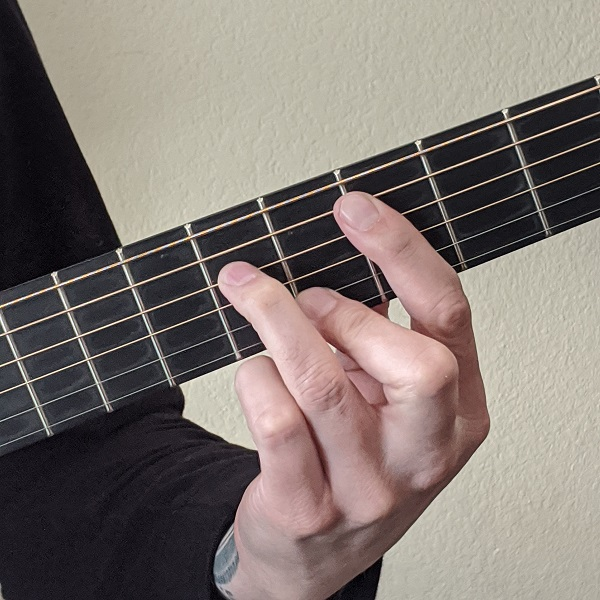 Playing a Minor Dominant Seventh Barre Chord on Guitar